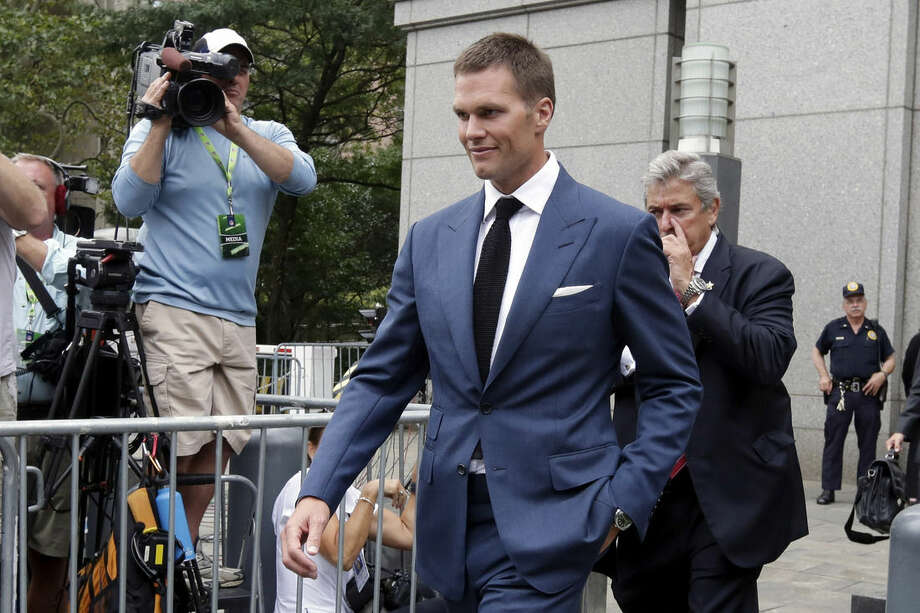 """FILE - In this Monday, Aug. 31, 2015, file photo, New England Patriots quarterback Tom Brady leaves federal court, in New York. Lawyers who want Brady to put """"Deflategate"""" behind him for good are ready to make their pitch to a New York appeals court. NFL lawyers are asking the 2nd U.S. Circuit Court of Appeals in Manhattan on Thursday, March 3, 2016, to reinstate Brady's four-game suspension. (AP Photo/Richard Drew, File)"""