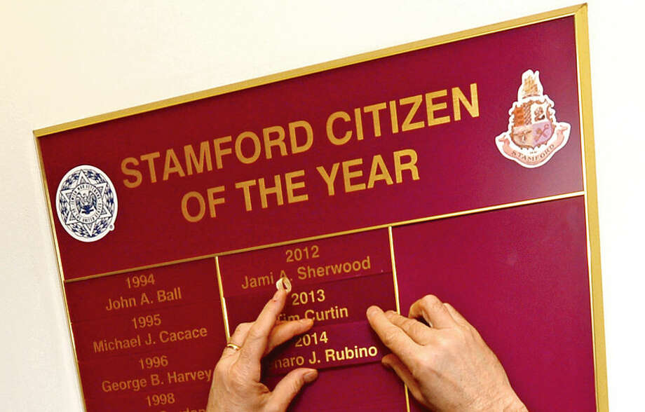 Hour photo / Erik Trautmann The City of Stamford Citizen of the Year Plaque Ceremony was held Tuesday morning at the Stamford Government Center. Gene Rubino's name plaque was added to those of the prior 69 Citizens of the Year honorees.