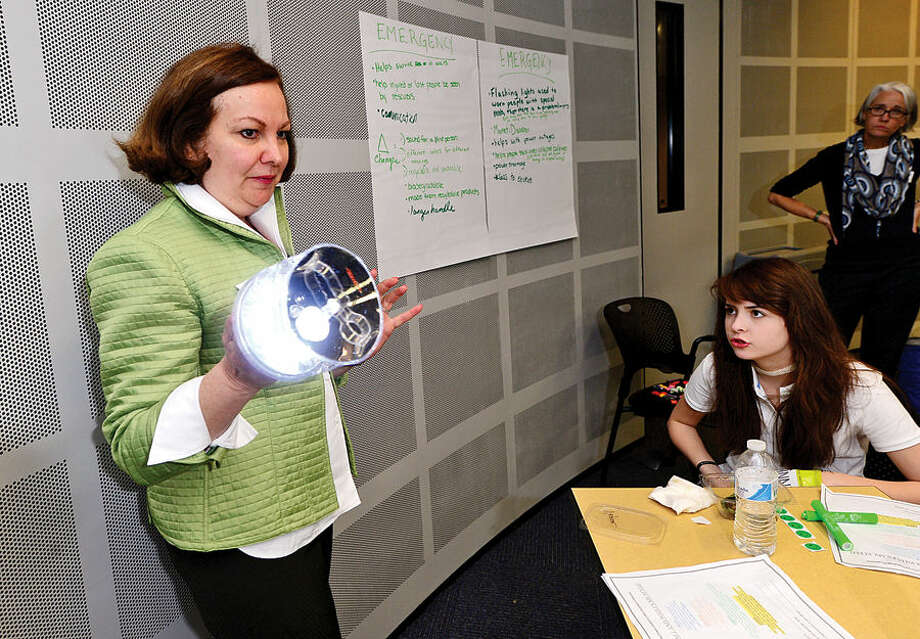 Hour photo / Erik Trautmann The International Womens Forum of Connecticut president Valarie Gelb hosts a group of Girl Scouts at the UCONN School of Business in Stamford for an interactive workshop focused on STEM (Science Technology Engineering and Math) featuring the solar powered Luci Light. The girlscouts worked with leading executive women from across the state to form product development and marketing strategies for an enhanced Luci Light.