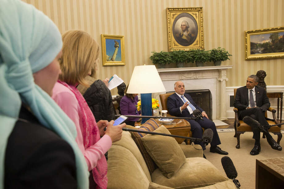 As U.S. and Iraqi journalists listen, Iraqi Prime Minister Haider Al-Abadi speaks during his meeting with President Barack Obama in the Oval Office of the White House in Washington, Tuesday, April 14, 2015. The Prime Minister is visiting to discuss U.S.-Iraq policy and the fight against the IS group. (AP Photo/Jacquelyn Martin)