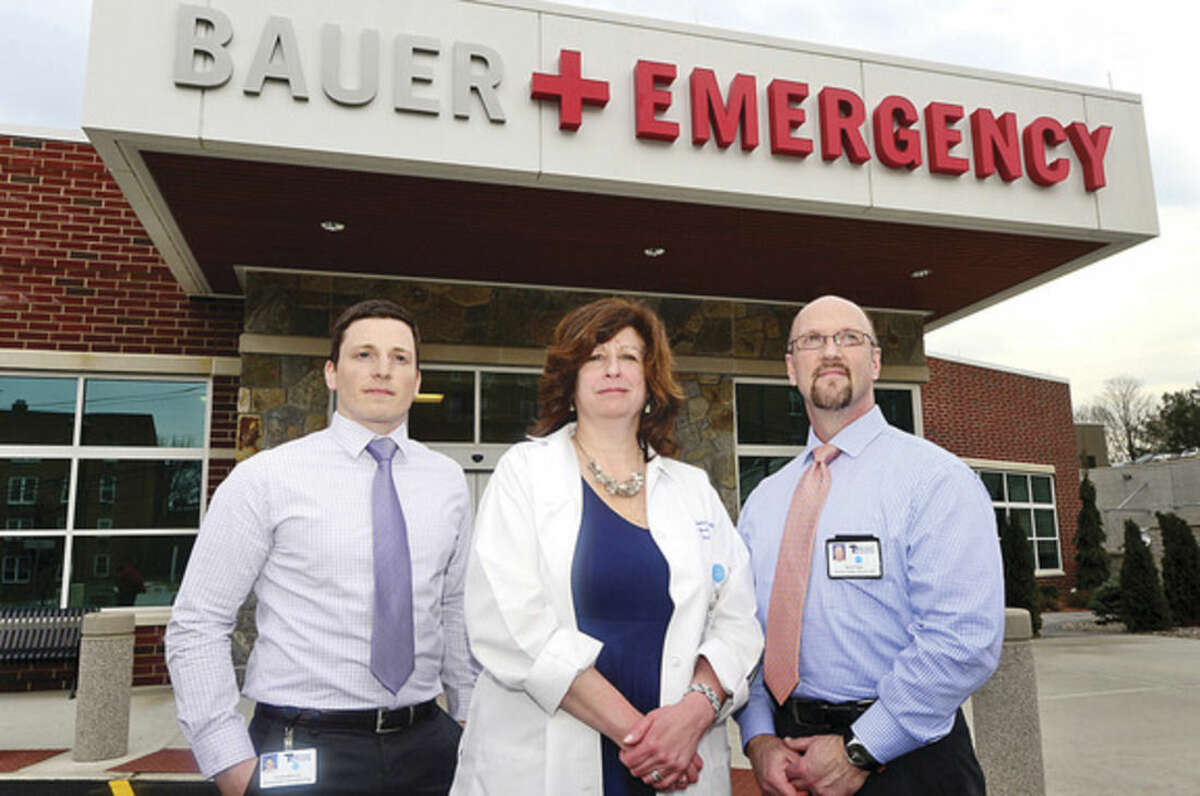 Hour photo / Erik Trautmann Norwalk Hospital staff; Tom Mahoney, Emergency Operations Manager, Steve Papp, Director of Facility Operations, Lorraine Salavec, Patient Care Manager liason emergency operations with local police and fire departments.
