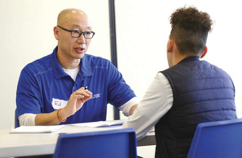 Hour photo / Erik Trautmann Sky Zone franchise owner Ed Kim interviews Abriel Gonzalez during the Sky Zone Job Fair in an effort to hire 120 people for their new location opening in Norwalk at the end of March.