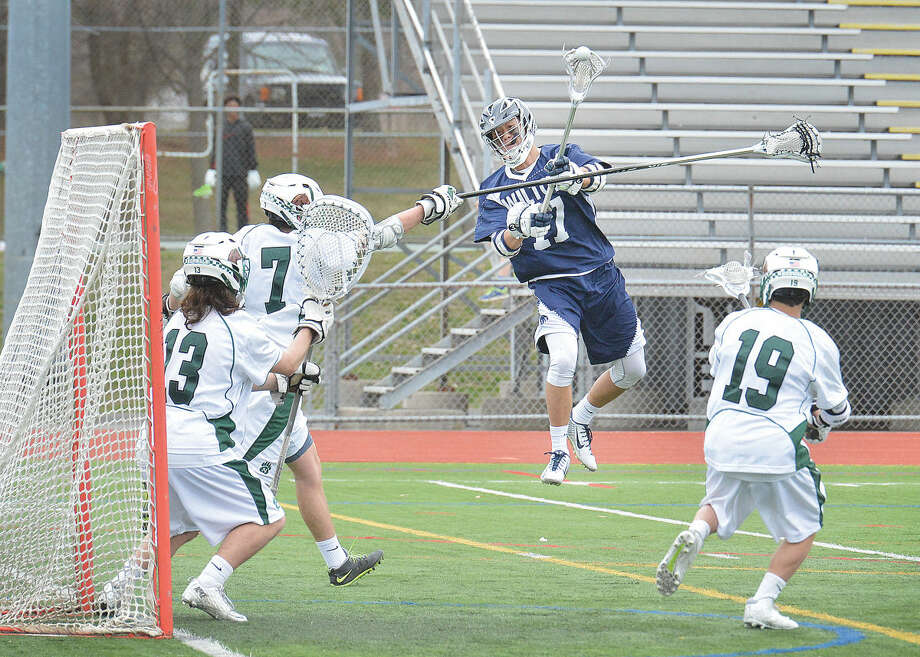 Wilton's Michael Lynch (17) shoots on net against Norwalk on Tuesday. (Hour Photo/Alex von Kleydorff)