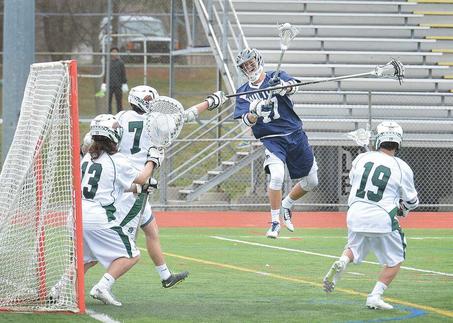 Wilton's Michael Lynch (17) shoots on net against Norwalk on Tuesday. (Hour Photo/Alex von Kleydorff)