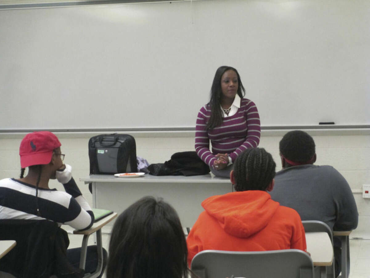Contributed photo Janeen Reid, supervisor of Adolescent Services for Specialized Foster Care, speaks to students about foster care before they kick off the luggage drive to help homeless and foster children.