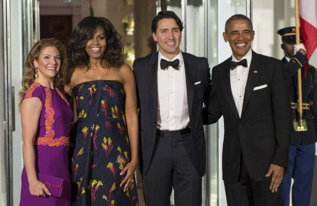 President Barack Obama and first lady Michelle Obama pose for a photo with Canadian Prime Minister Justin Trudeau and Sophie Gregoire Trudeau at the North Portico of the White House in Washington, Thursday, March 10, 2016, as they arrive for a state dinner. (Paul Chiasson/The Canadian Press via AP) MANDATORY CREDIT