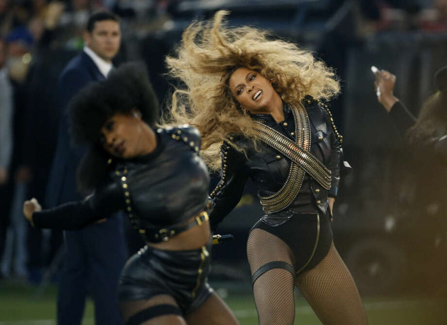 FILE - In this Sunday, Feb. 7, 2016 file photo, Beyonce performs during halftime of the NFL Super Bowl 50 football game in Santa Clara, Calif. Beyonce is working overtime this weekend: After releasing a new song Saturday and performing at the Super Bowl on Sunday, she's announced a new stadium tour. The Grammy-winning singer announced her 2016 Formation World Tour in a commercial after she performed at the halftime show with Bruno Mars and Coldplay. (AP Photo/Matt Slocum, File)