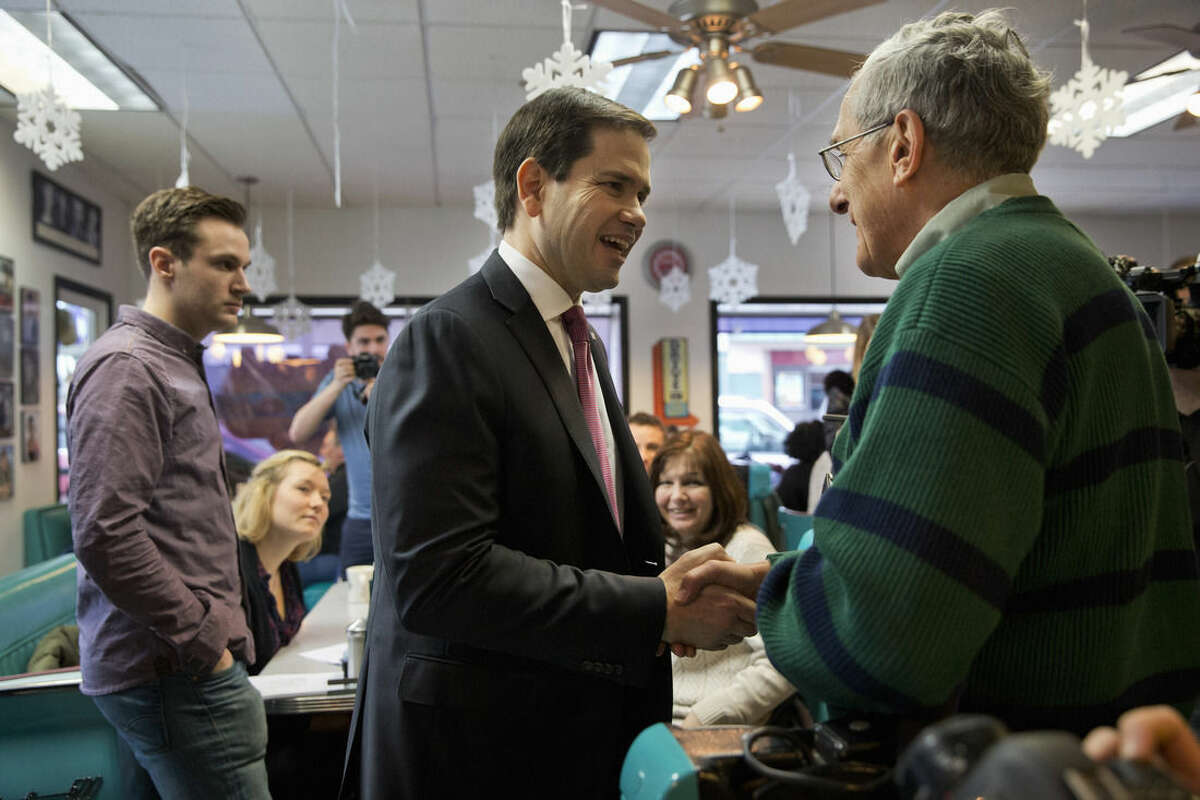 Republican presidential candidate, Sen. Marco Rubio, R-Fla. greets patrons during a campaign stop at Norton's Classic Cafe in Nashua, N.H., Monday Feb. 8, 2016. (AP Photo/Jacquelyn Martin)