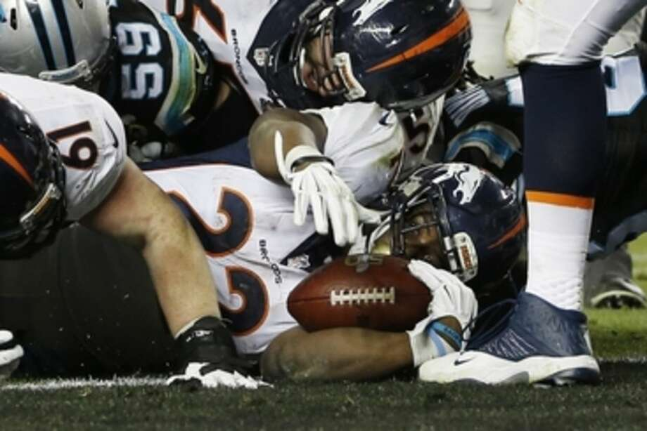 Denver Broncos' C.J. Anderson (22) scores a touchdown against the Carolina Panthers during the second half of the NFL Super Bowl 50 football game Sunday, Feb. 7, 2016, in Santa Clara, Calif. (AP Photo/Matt Slocum)