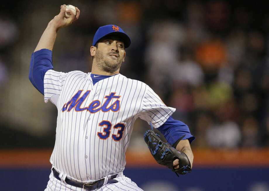 New York Mets starting pitcher Matt Harvey (33) delivers during the first inning of a baseball game against the Philadelphia Phillies in New York, Tuesday, April 14, 2015. (AP Photo/Kathy Willens)