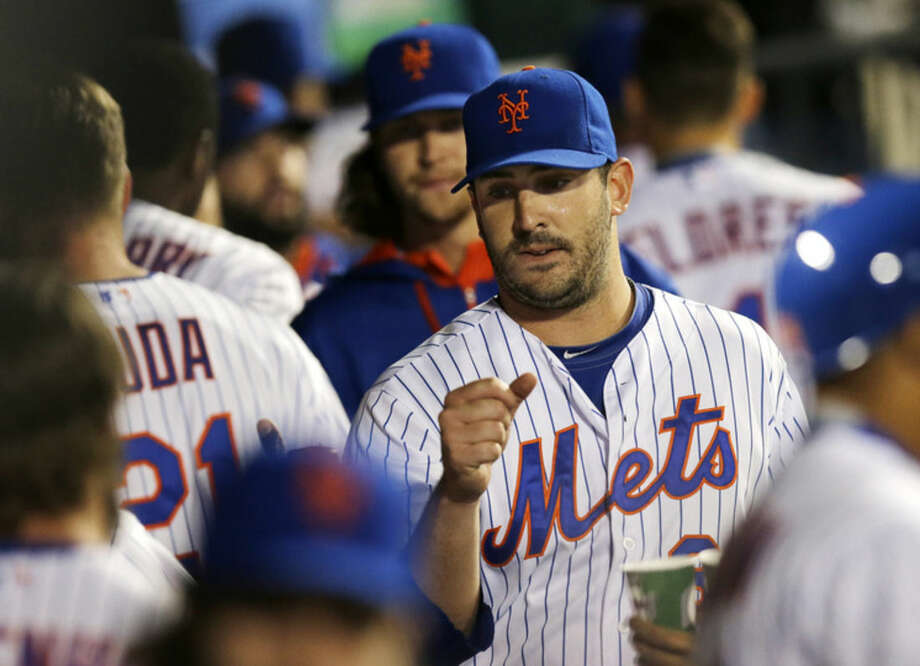 New York Mets starting pitcher Matt Harvey returns to the dugout to greetings after the top of the sixth inning of the team's baseball game against the Philadelphia Phillies in New York, Tuesday, April 14, 2015. (AP Photo/Kathy Willens)