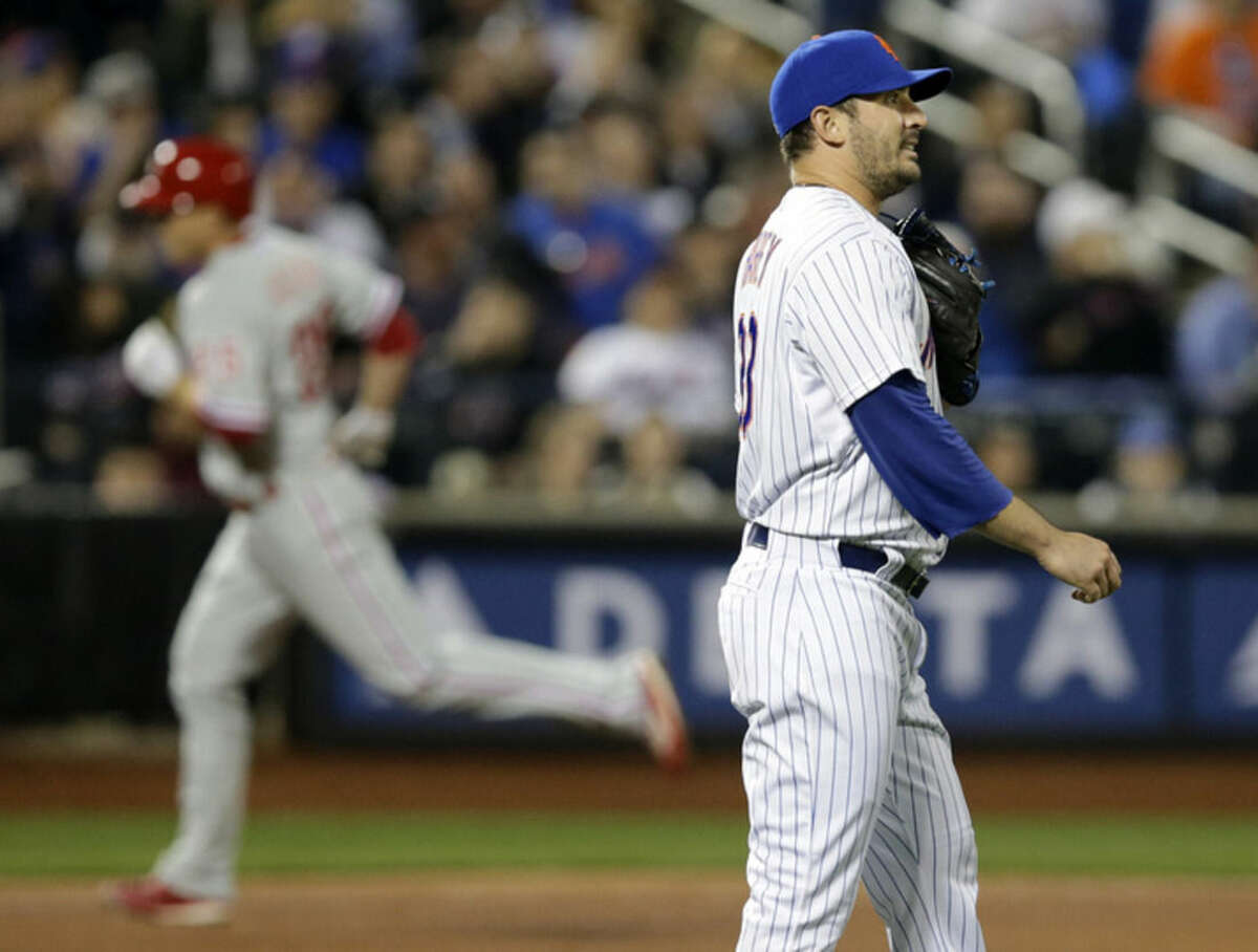 New York Mets starting pitcher Matt Harvey, right, waits as Philadelphia Phillies Cody Asche rounds the bases after hitting a fourth-inning solo home run in a baseball game in New York, Tuesday, April 14, 2015. (AP Photo/Kathy Willens)