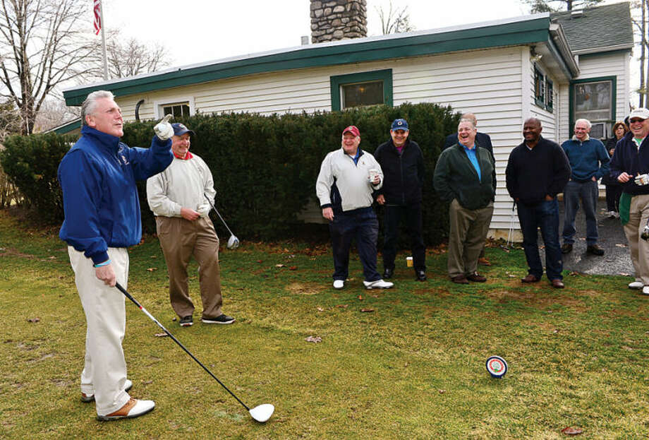 Hour photo / Erik Trautmann Norwalk mayor Harry Rlling prepares to hit the ceremonial first ball to usher in the official golf season at Oak Hills Park Saturday.