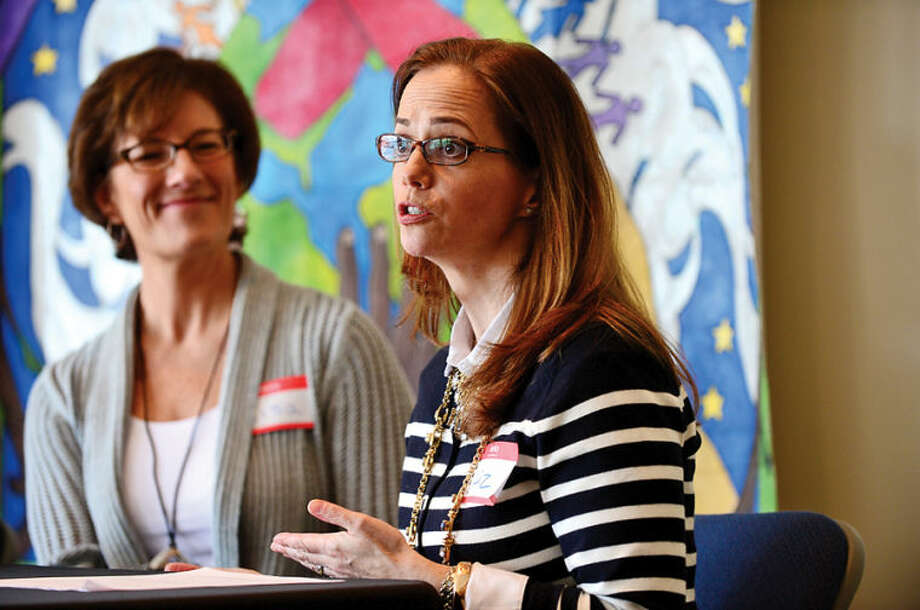 Hour photo / Erik Trautmann Psychologist Lisa Tuttle speaks at a panel discussion with reproductive experts Dr. Mark Leondires and attorney Liz Faulker, during the kick off for the Family Building Series at the Triangle Community Center Saturday.