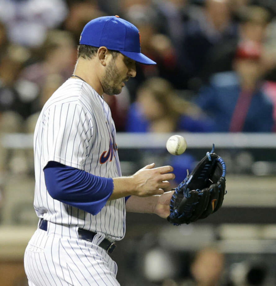 New York Mets starting pitcher Matt Harvey returns to the mound after giving up the second run in the third inning of a baseball game against the Philadelphia Phillies in New York, Tuesday, April 14, 2015. (AP Photo/Kathy Willens)