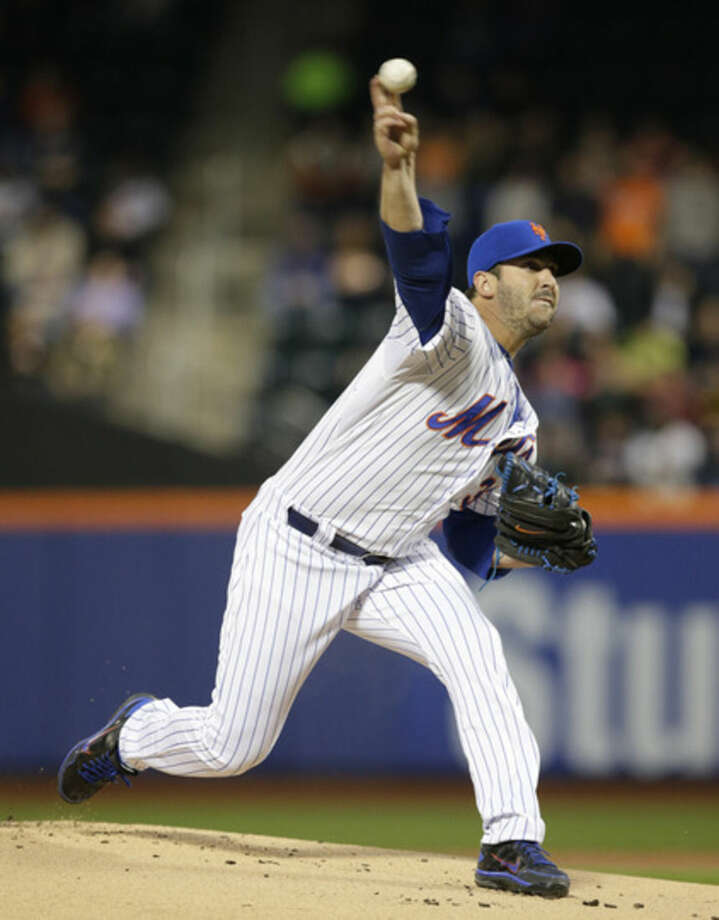 New York Mets starting pitcher Matt Harvey delivers in the first inning of a baseball game against the Philadelphia Phillies in New York, Tuesday, April 14, 2015. (AP Photo/Kathy Willens)