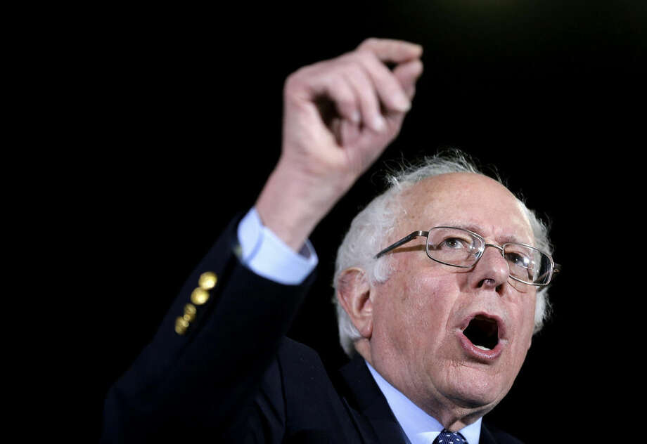 Democratic presidential candidate Sen. Bernie Sanders, I-Vt., addresses an audience during a campaign rally Monday, Feb. 22, 2016, in Amherst, Mass. (AP Photo/Steven Senne)