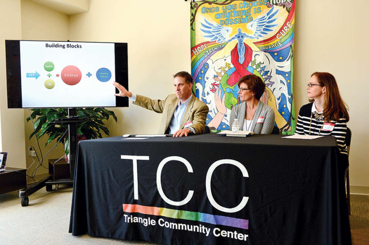 Hour photo / Erik TrautmannDr. Mark Leondires speaks at a panel discussion with reproductive experts, attorney Liz Faulker and psychologistLisa Tuttle at the Triangle Community Center during the kick off for it's Family Building Series Saturday.