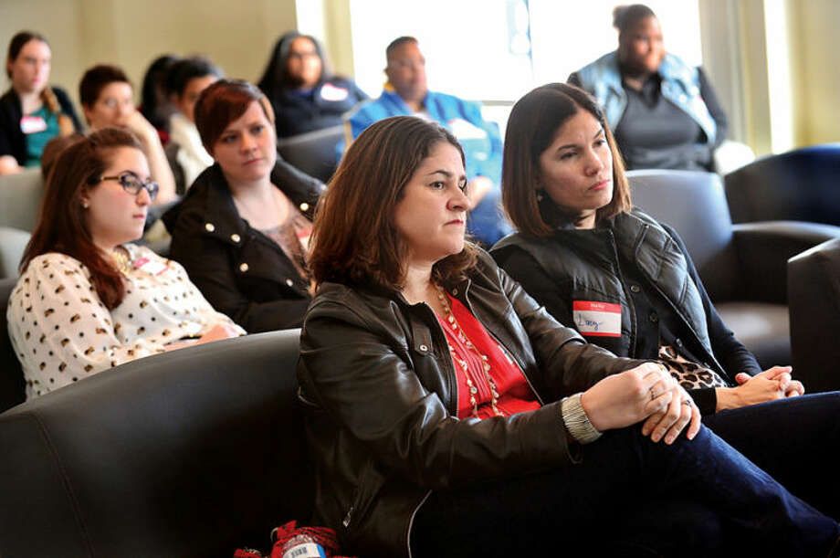 Hour photo / Erik Trautmann Couples listen to a panel discussion with reproductive experts Dr. Mark Leondires, attorney Lisa Tuttle, and psychologist Liz Faulker at the Triangle Community Center during the kick off for it's Family Building Series Saturday.