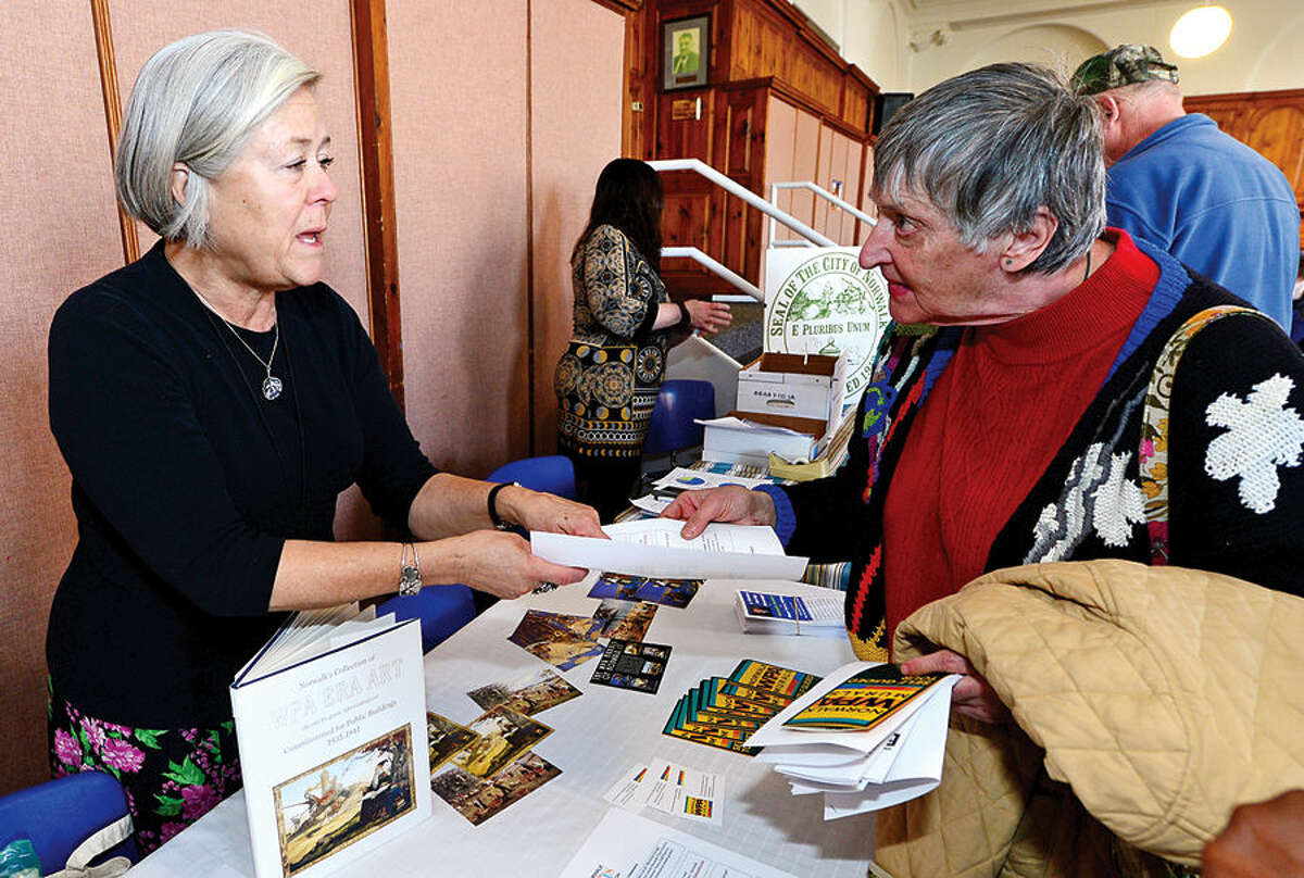 Hour photo / Erik Trautmann Susan Wallerstein of the Norwalk Arts Commission chats with seniors during Senior Citizens' Connection Day where seniors garnered information on cost-savings opportunities including tax relief offered Wednesday in Community Room at Norwalk City Hall.