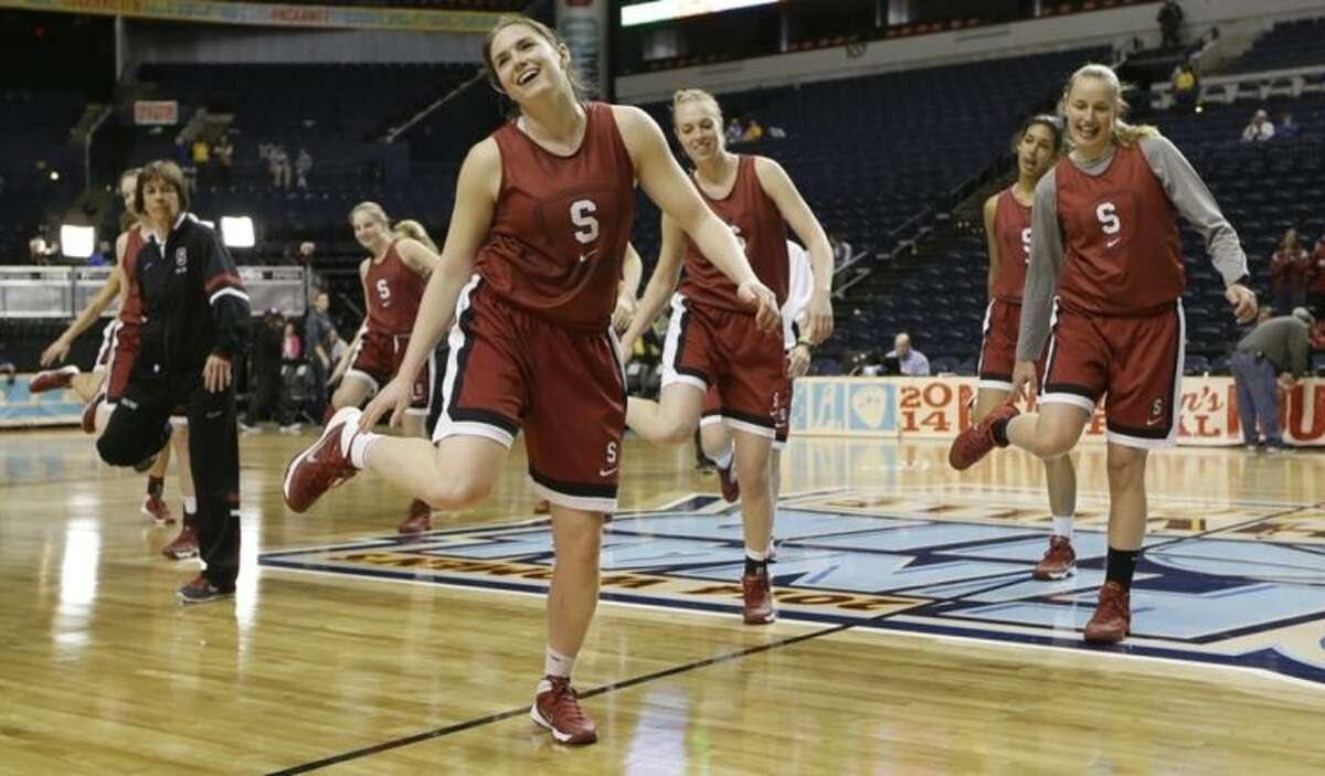 Stanford's Sara James and head coach Tara VanDerveer with the rest of the team perform a line dance after practice before the women's Final Four of the NCAA college basketball tournament, Saturday, April 5, 2014, in Nashville, Tenn. Connecticut plays Stanford Sunday. (AP Photo/Mark Humphrey)