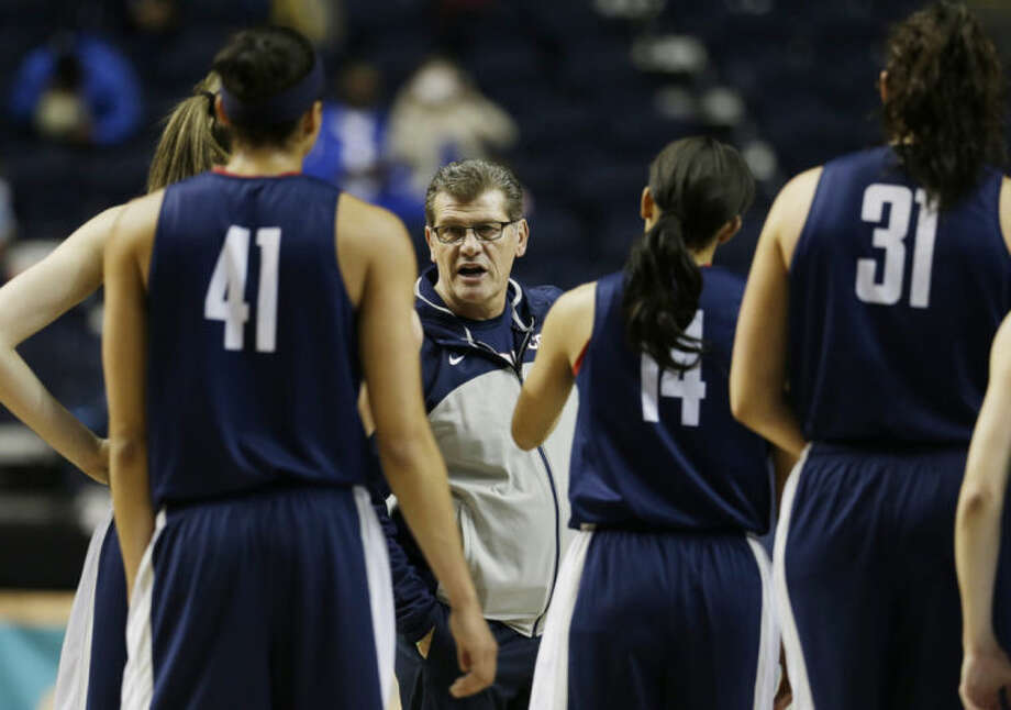 Connecticut head coach Geno Auriemma speaks to players during practice before the women's Final Four of the NCAA college basketball tournament, Saturday, April 5, 2014, in Nashville, Tenn. Connecticut plays Stanford Sunday. (AP Photo/Mark Humphrey)