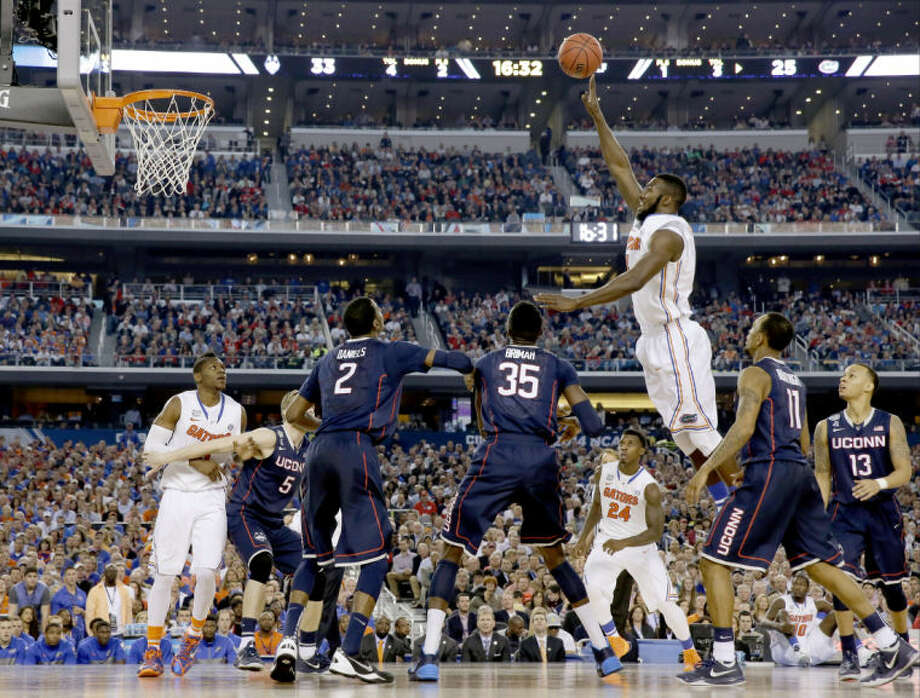 Florida center Patric Young shoots against Connecticut during the second half of the NCAA Final Four tournament college basketball semifinal game Saturday, April 5, 2014, in Arlington, Texas. (AP Photo/David J. Phillip)
