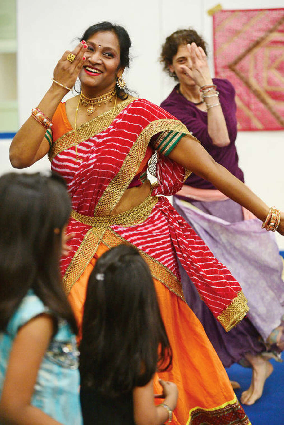Hour photo / Erik Trautmann Nimi Clarence teaches Bollywood Zumba during an Indian Spring Festival at the Wilton Family YMCA Saturday afternoon.