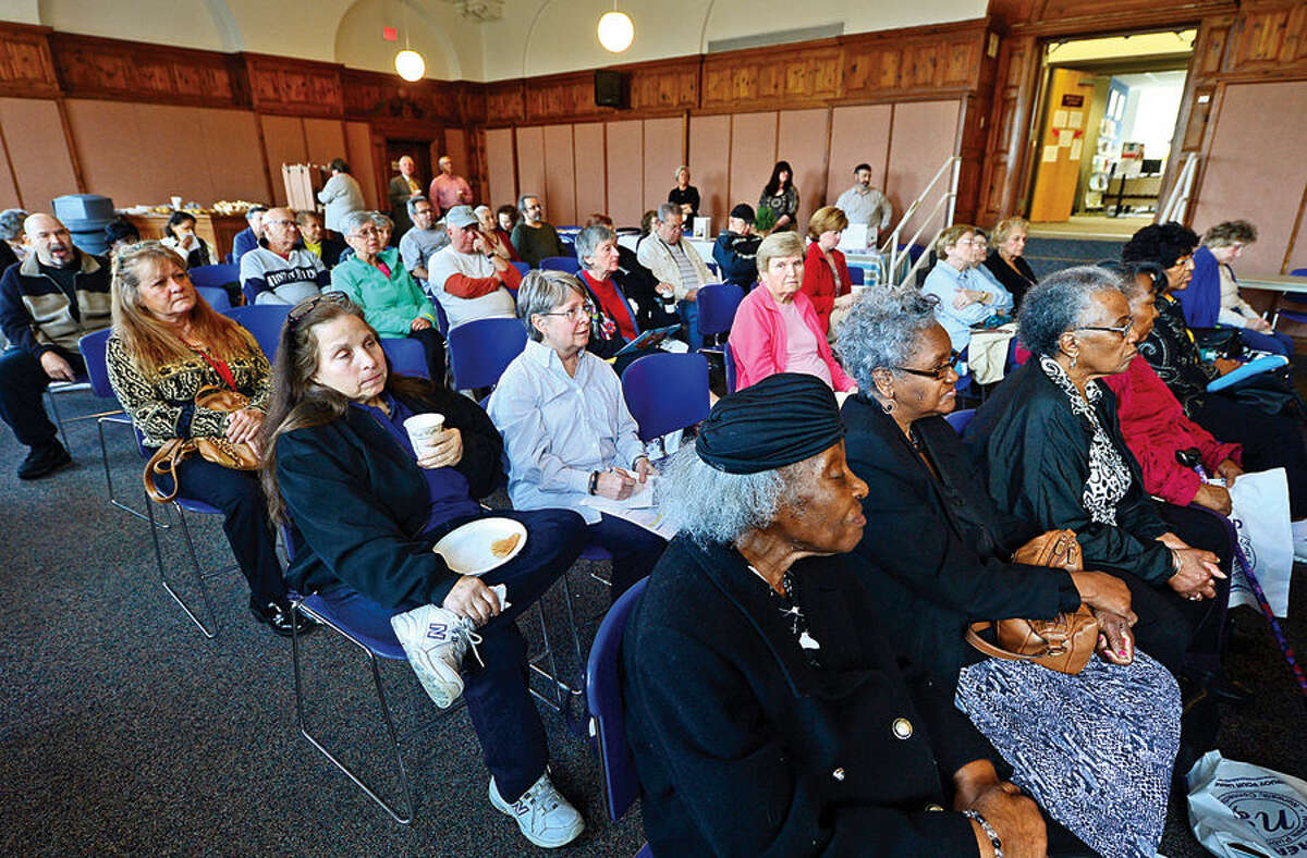 Hour photo / Erik Trautmann Seniors gathered for Senior Citizens' Connection Day where information on cost-savings opportunities including tax relief was offered Wednesday in Community Room at Norwalk City Hall.