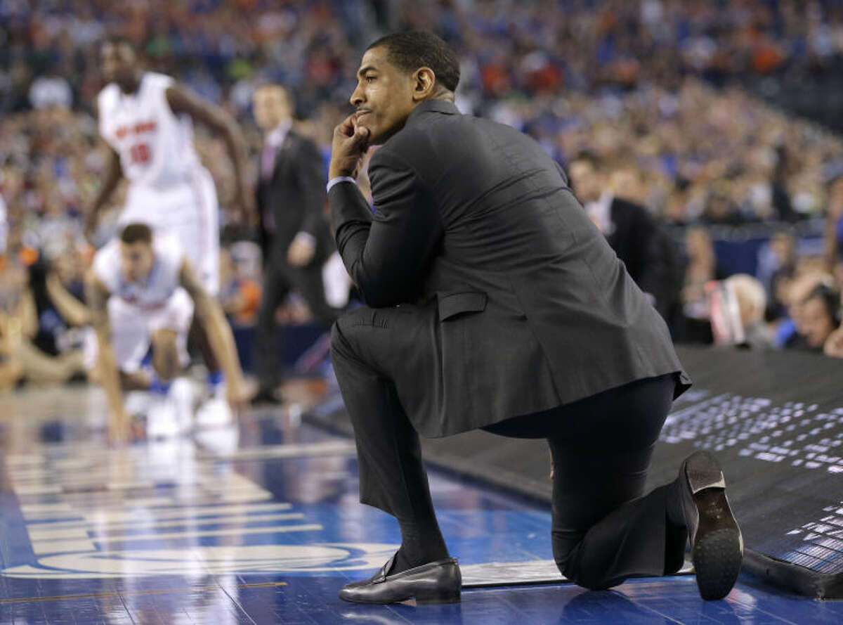 Connecticut head coach Kevin Ollie looks on during the second half of the NCAA Final Four tournament college basketball semifinal game against Florida Saturday, April 5, 2014, in Arlington, Texas. (AP Photo/Eric Gay)