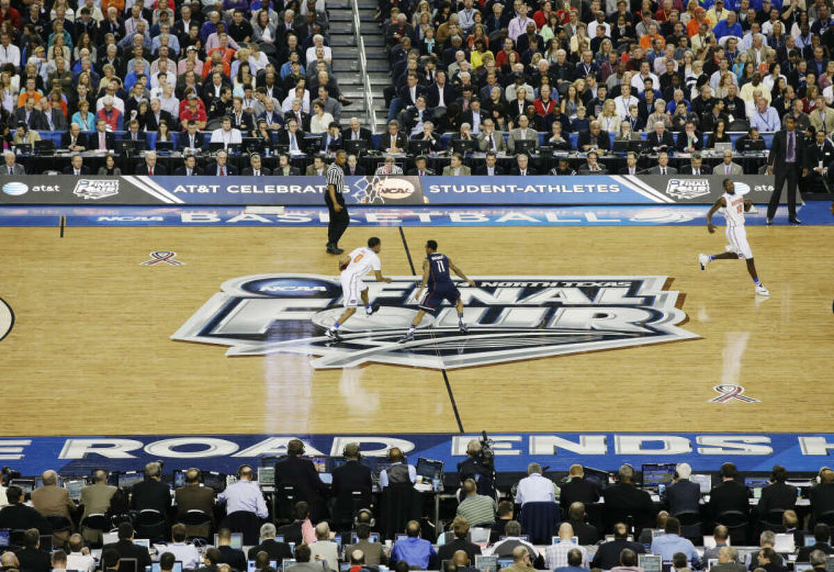 Florida guard Kasey Hill (0) takes the ball down court as Connecticut guard Ryan Boatright (11) defends during the first half of the NCAA Final Four tournament college basketball semifinal game Saturday, April 5, 2014, in Arlington, Texas. (AP Photo/Tony Gutierrez)