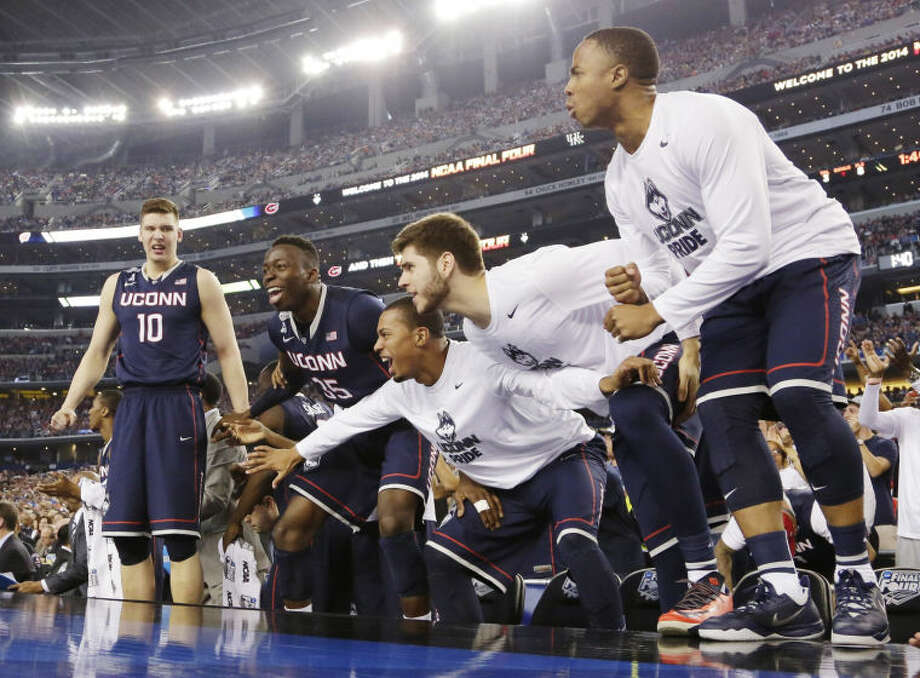 Connecticut players celebrate against Florida in the final moments of the NCAA Final Four tournament college basketball semifinal game Saturday, April 5, 2014, in Arlington, Texas. Connecticut won 63-53. (AP Photo/Eric Gay)