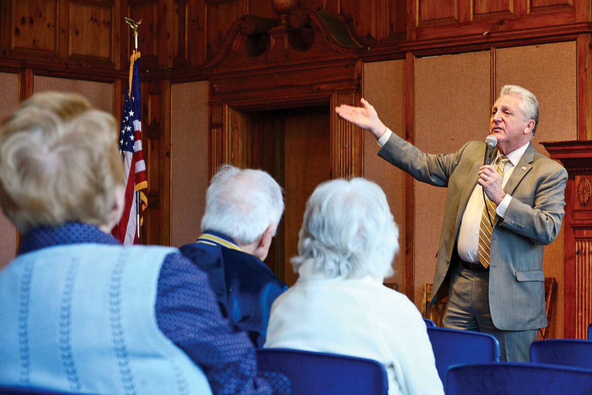 Hour photo / Erik Trautmann Mayor Harry Riling invites Norwalk senior citizens to Senior Citizens' Connection Day for information on cost-savings opportunities for seniors including tax relief offered Wednesday in Community Room at Norwalk City Hall.