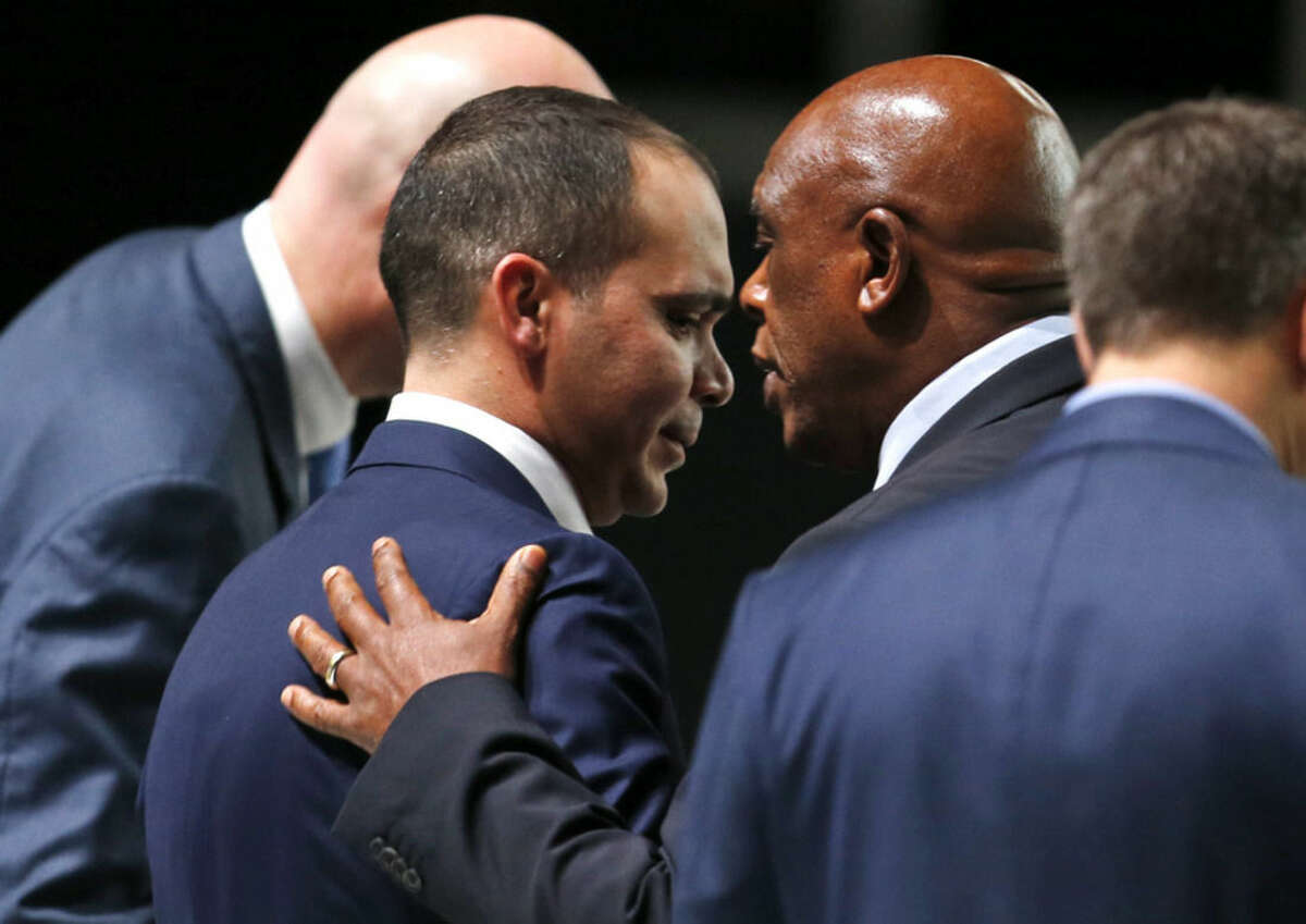 FIFA presidential candidate Tokyo Sexwale of South Africa, right, talks to FIFA presidential candidate Prince Ali Al-Hussein of Jordan during the extraordinary FIFA congress in Zurich, Switzerland, Friday, Feb. 26, 2016. Delegates of the soccer body FIFA meet to elect a new president. (AP Photo/Michael Probst)