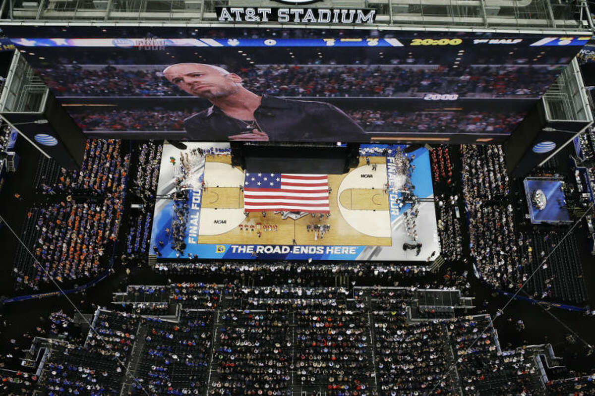Chris Daughrty performs the U.S. national anthem before an NCAA Final Four tournament college basketball semifinal game between Connecticut and Florida Saturday, April 5, 2014, in Arlington, Texas. (AP Photo/David J. Phillip)