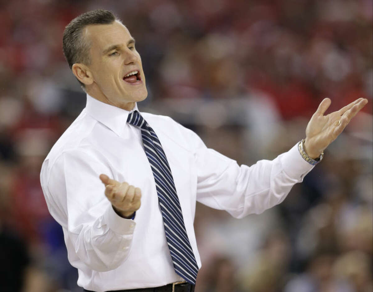 Florida head coach Billy Donovan redacts during the second half of an NCAA Final Four tournament college basketball semifinal game against Connecticut Saturday, April 5, 2014, in Arlington, Texas. (AP Photo/David J. Phillip)