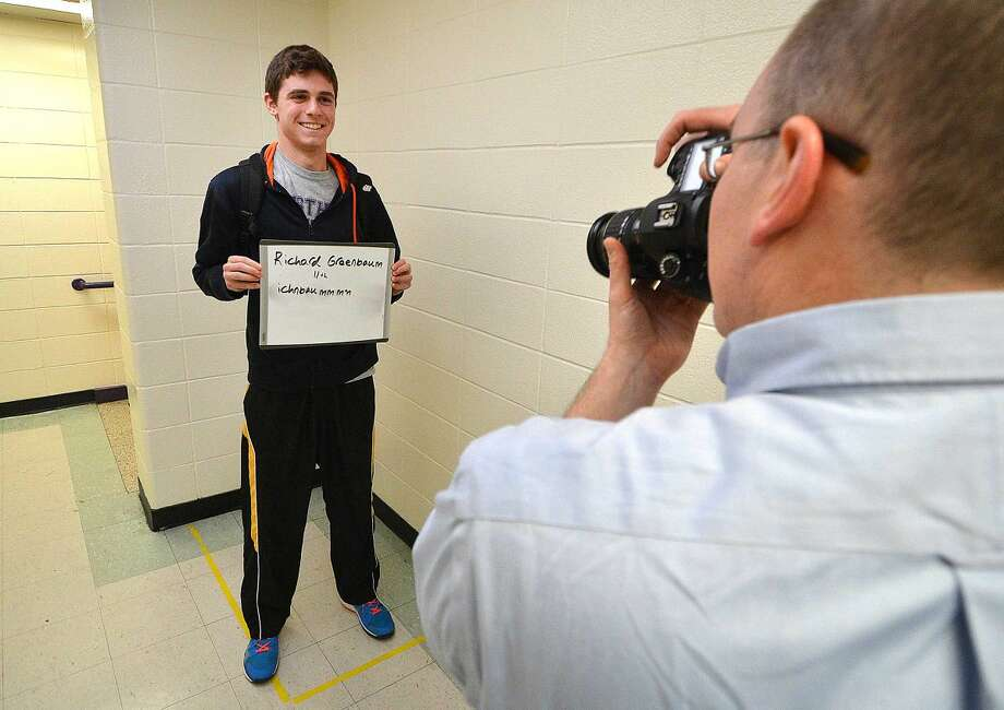 Westhill High School Junior Richard Greenbaum has his photo taken as students and teachers and administrators turn out for an open casting call to be included in the 2015-2016 College Board brochures.