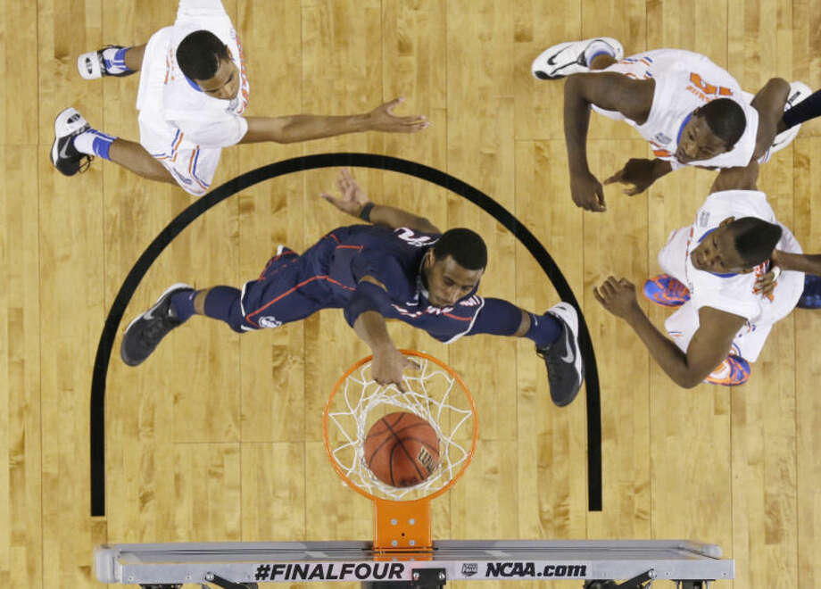 Connecticut forward DeAndre Daniels dunks the ball during the second half of the NCAA Final Four tournament college basketball semifinal game against Florida Saturday, April 5, 2014, in Arlington, Texas. (AP Photo/David J. Phillip)
