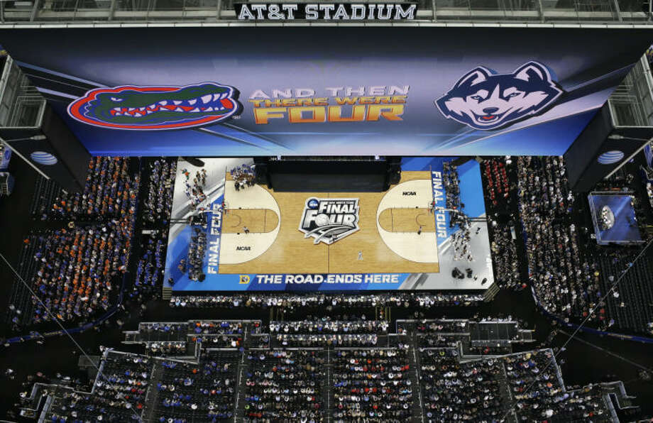 Fans look on during the first half of an NCAA Final Four tournament college basketball semifinal game between Connecticut and Florida Saturday, April 5, 2014, in Arlington, Texas. (AP Photo/David J. Phillip)