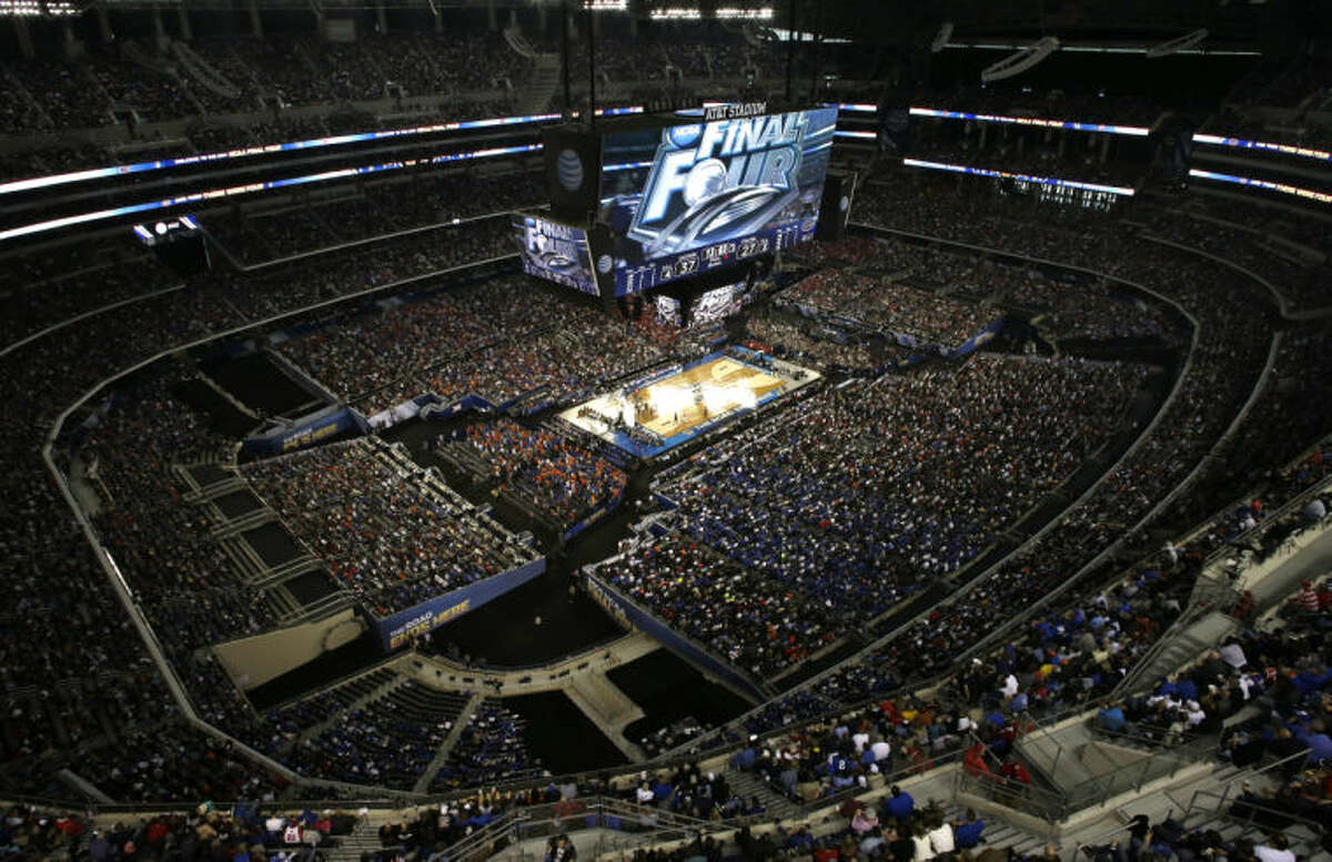 Fans watch during the second half of an NCAA Final Four tournament college basketball semifinal game between Connecticut and Florida Saturday, April 5, 2014, in Arlington, Texas. (AP Photo/David J. Phillip)