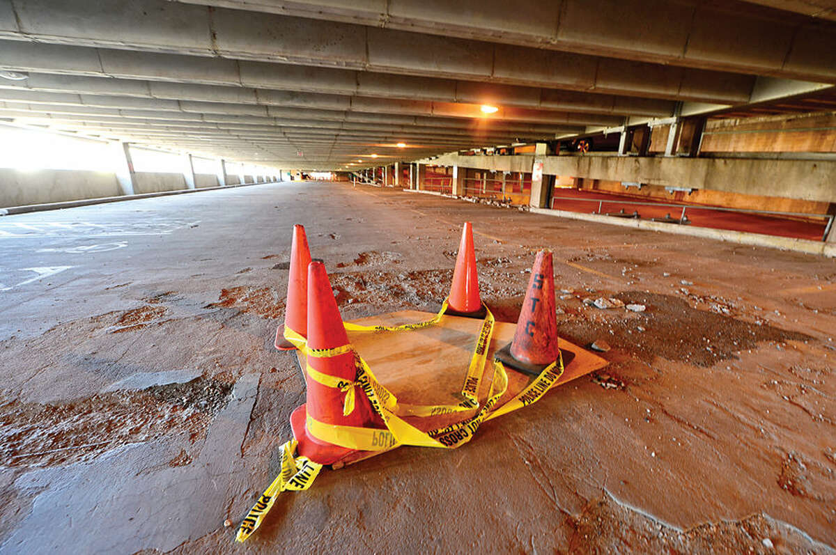 The Connecticut Department of Transportation has partially closed its 28-year-old parking garage in downtown Stamford after chunks of concrete fell through the third floor to the second-level deck over the weekend.