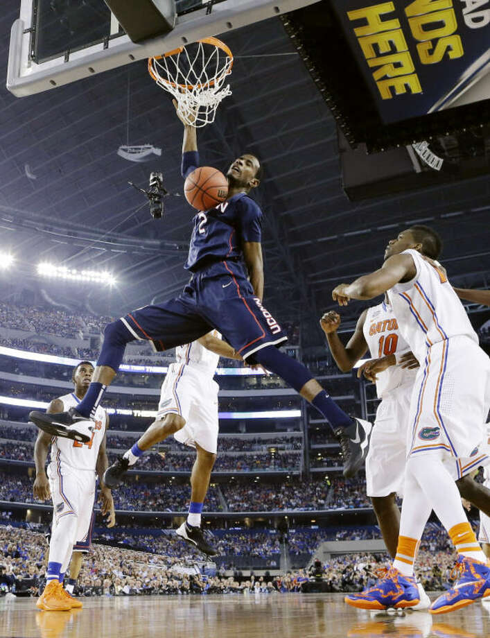 Connecticut forward DeAndre Daniels (2) dunks the ball against Florida during the second half of the NCAA Final Four tournament college basketball semifinal game Saturday, April 5, 2014, in Arlington, Texas. (AP Photo/Eric Gay)