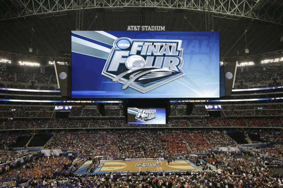Fans look on during the first half of an NCAA Final Four tournament college basketball semifinal game between Connecticut and Florida Saturday, April 5, 2014, in Arlington, Texas. (AP Photo/Tony Gutierrez)
