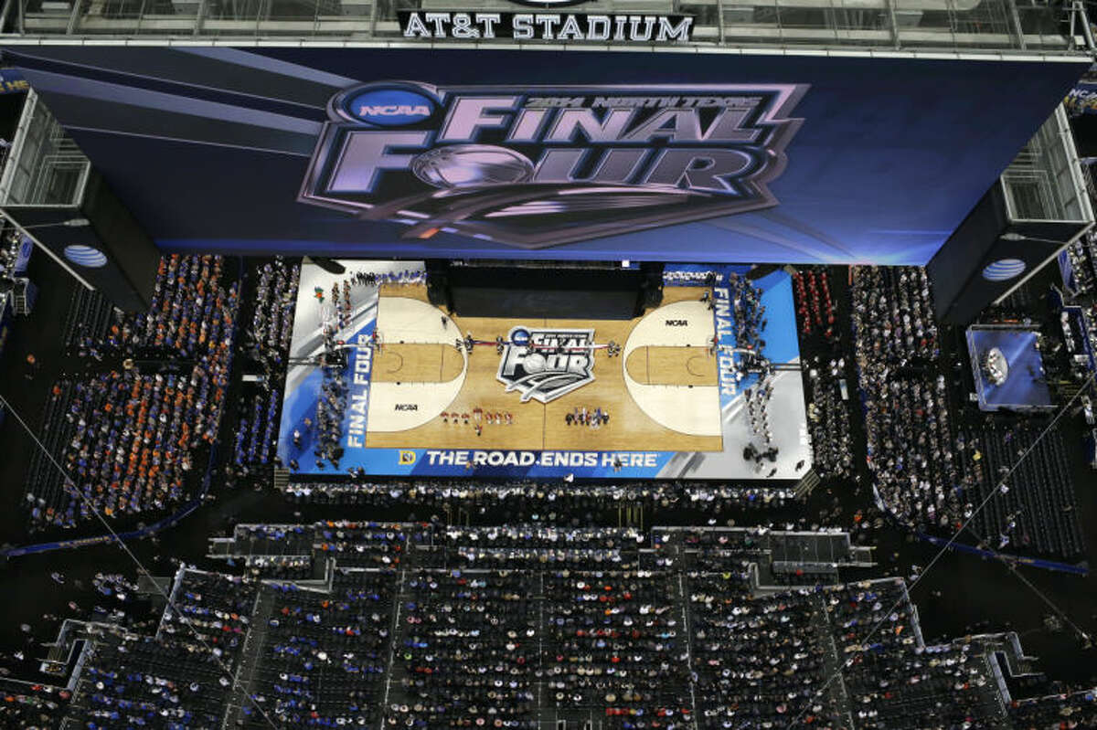 Fans look on before an NCAA Final Four tournament college basketball semifinal game between Connecticut and Florida Saturday, April 5, 2014, in Arlington, Texas. (AP Photo/David J. Phillip)