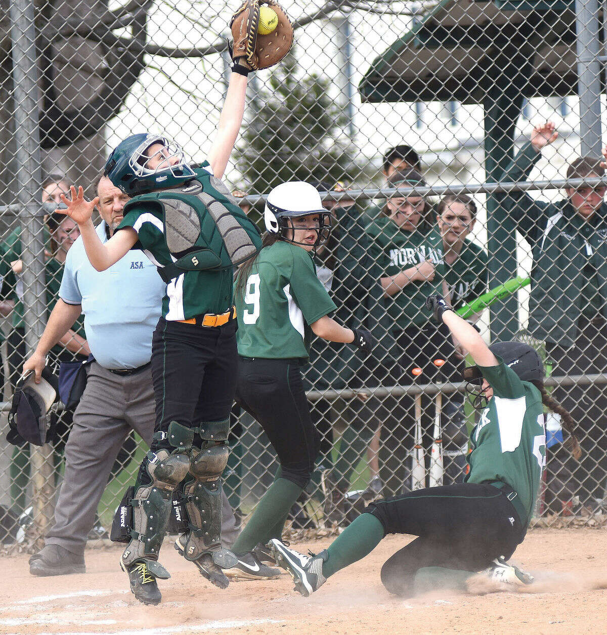 Norwalk's Katie Sciglimpaglia slides into home plate safely in the Bears' 9-8 win over Trinity Catholic on Wednesday. (John Nash/Hour photo)