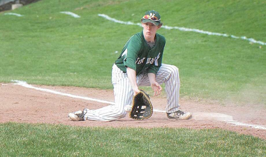 Hour Photo/Alex von Kleydorff Norwalks #13 Ryan Searles makes the out at first base vs Trinity Catholic