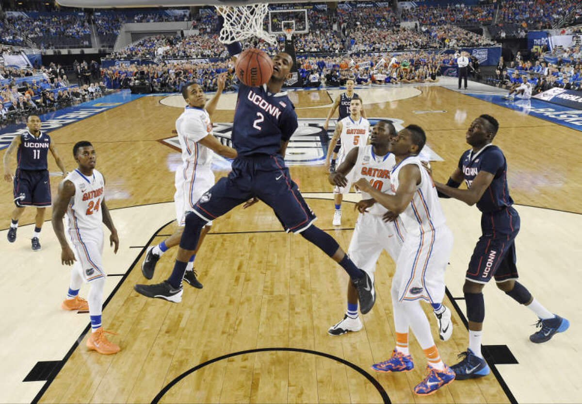 Connecticut forward DeAndre Daniels (2) dunks against Florida during the second half of the NCAA Final Four tournament college basketball semifinal game Saturday, April 5, 2014, in Arlington, Texas. (AP Photo/Chris Steppig, pool)