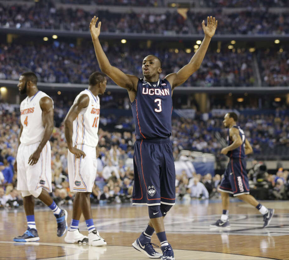 Connecticut guard Terrence Samuel celebrates against Florida during the second half of the NCAA Final Four tournament college basketball semifinal game Saturday, April 5, 2014, in Arlington, Texas. (AP Photo/Eric Gay)