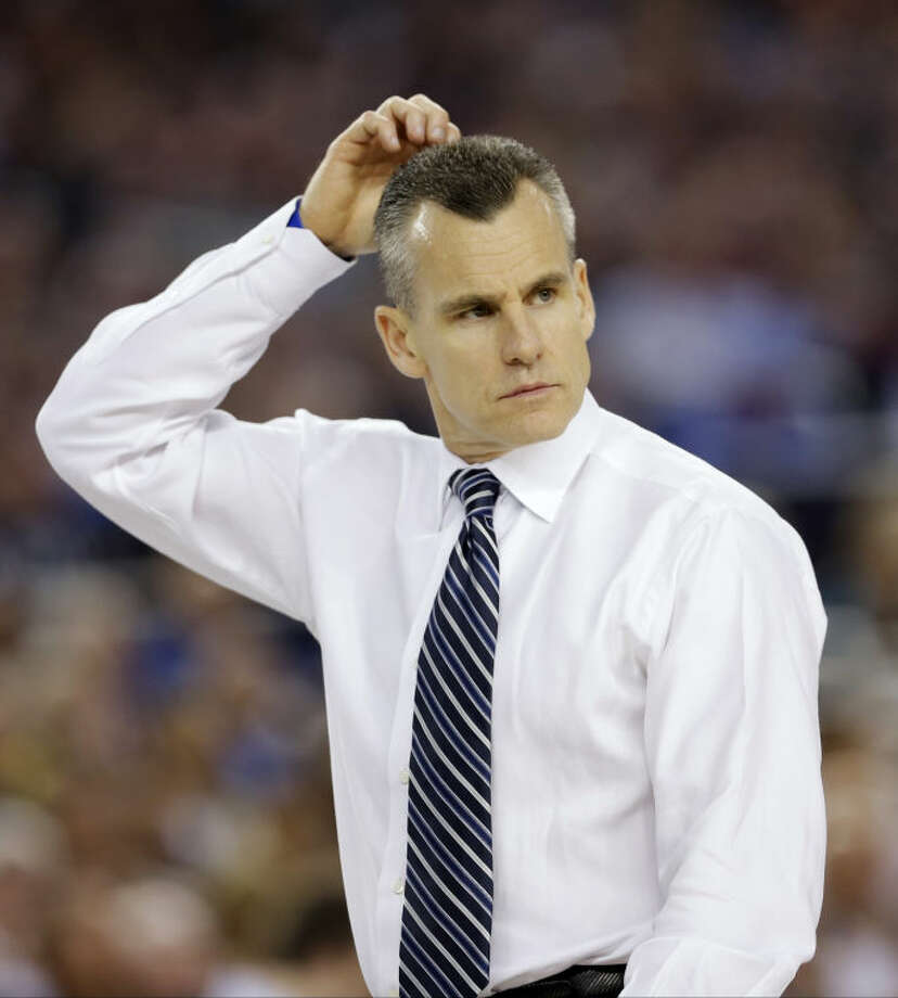 Florida head coach Billy Donovan watches action against Connecticut during the second half of the NCAA Final Four tournament college basketball semifinal game Saturday, April 5, 2014, in Arlington, Texas. (AP Photo/David J. Phillip)