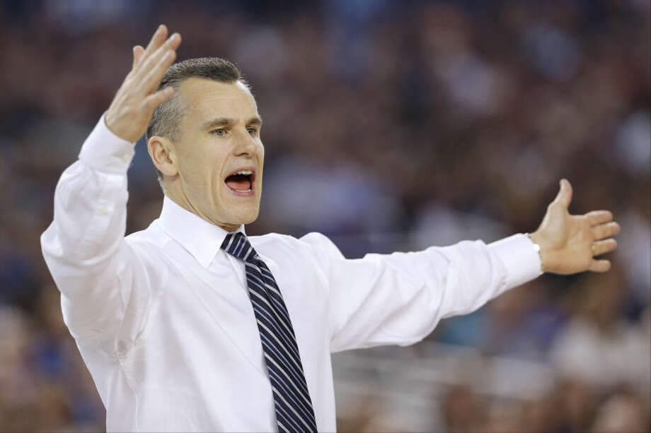 Florida head coach Billy Donovan works the sideline against Connecticut during the second half of the NCAA Final Four tournament college basketball semifinal game Saturday, April 5, 2014, in Arlington, Texas. (AP Photo/David J. Phillip)